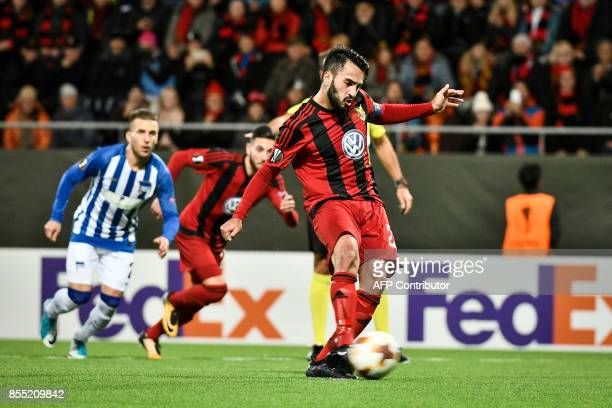 Ostersund's Iraqi midfielder Brwa Nouri shoots to score a penalty during the UEFA Europa League group J football match between Ostersund FK and...