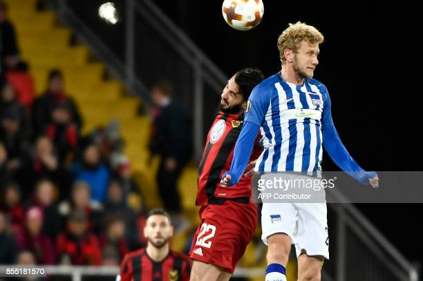 Osterund's Iraqi midfielder Brwa Nouri and Berlin's Swiss midfielder Fabian Lustenberger vie for the ball during the UEFA Europa League group J...