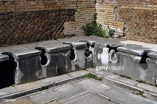 Ostia Antica Latrine at the Domus of Triclini headquarters of the guild of builders 2nd century AD Near Rome