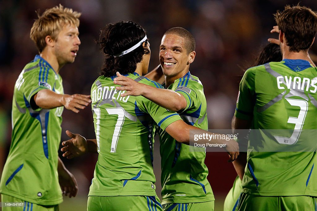 Osvaldo Alonso (2R) #6 of the Seattle Sounders FC celebrates his game winning goal in the 65th minute with teammate <a gi-track='captionPersonalityLinkClicked' href=/galleries/search?phrase=Fredy+Montero&family=editorial&specificpeople=5563695 ng-click='$event.stopPropagation()'>Fredy Montero</a> (2L) #17 of the Seattle Sounders FC against the Colorado Rapids at Dick's Sporting Goods Park on July 28, 2012 in Commerce City, Colorado. The Sounders defeated the Rapids 2-1.