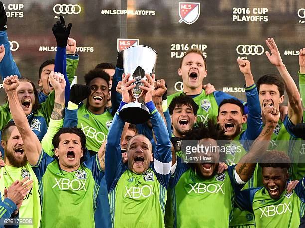 Osvaldo Alonso of Seattle Sounders holds up the MLS Western Conference Trophy after defeating the Colorado Rapids 10 at Dick's Sporting Goods Park on...