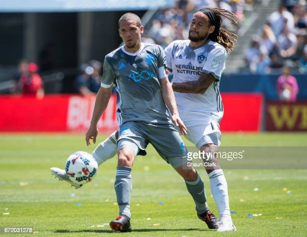 Osvaldo Alonso of Seattle Sounders is defended by Jermaine Jones of Los Angeles Galaxy during Los Angeles Galaxy's MLS match against Seattle Sounders...