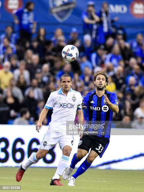 Osvaldo Alonso of the Seattle Sounders and Marco Donadel of the Montreal Impact run after the ball during the MLS game at Olympic Stadium on March 11...