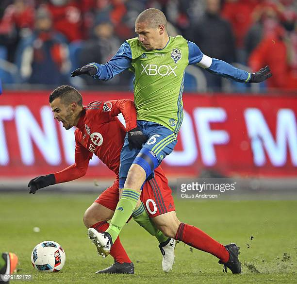 Osvaldo Alonso of the Seattle Sounders battles against Sebastian Giovinco of the Toronto FC during the 2016 MLS Cup at BMO Field on December 10 2016...