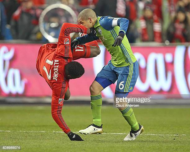 Osvaldo Alonso of the Seattle Sounders takes down Jozy Altidore of the Toronto FC in the 2016 MLS Cup at BMO Field on December 10 2016 in Toronto...