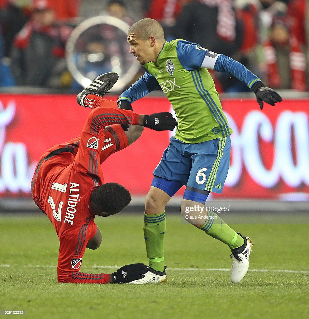 Osvaldo Alonso #6 of the Seattle Sounders upends Jozy Altidore #17 of the Toronto FC during the 2016 MLS Cup at BMO Field on December 10, 2016 in Toronto, Ontario, Canada. Seattle defeated Toronto in the 6th round of extra time penalty kicks.