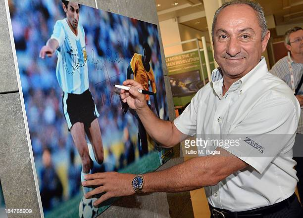Osvaldo Ardiles signs a picture prior to the Golden Foot Award press conference at Grimaldi Forum on October 16 2013 in Monaco Monaco