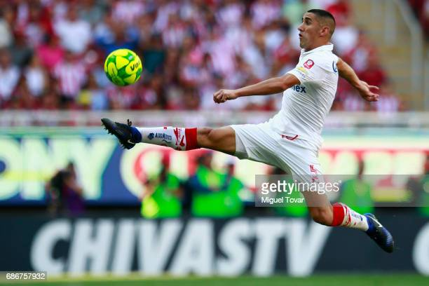 Osvaldo Gonzalez of Toluca jumps to control the ball during the semi final second leg match between Chivas and Toluca as part of the Torneo Clausura...