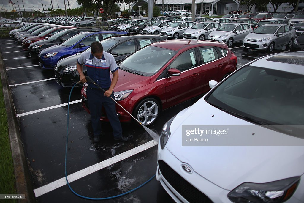 Osvaldo Leon washes new cars on the sales lot of a Ford AutoNation car dealership on & Pick-Up Trucks Drive Ford Sales Up 12 Percent In August Photos and ... markmcfarlin.com