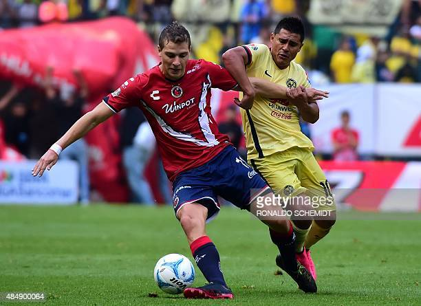 Osvaldo Martinez of America vies for the ball with Julio Furch of Veracruz during their Mexican Apertura tournament football match at the Azteca...