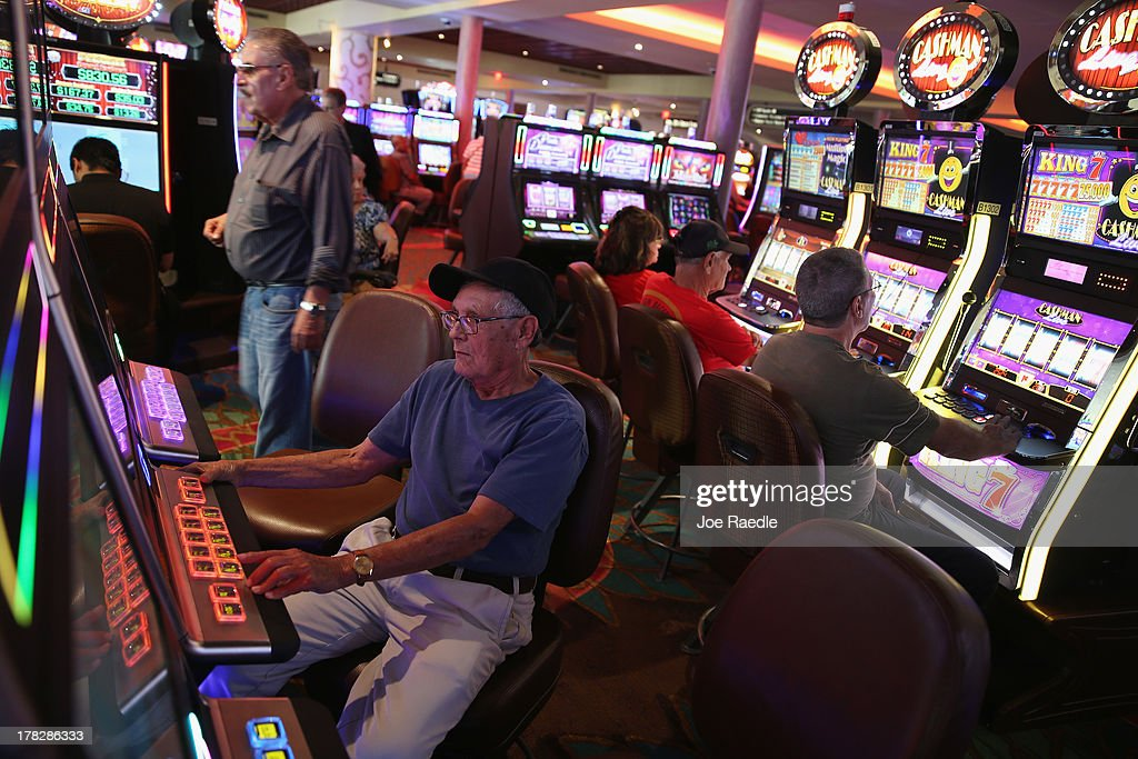Osvaldo Rodriguez enjoys playing a slot machine in the casino that will hold its grand opening on Friday located in the Hialeah Park Race Track which first opened in 1925 on August 28, 2013 in Hialeah, Florida. The new casino is located in the same complex as the race track which in its heyday was known as the 'the worlds most beautiful race course.'