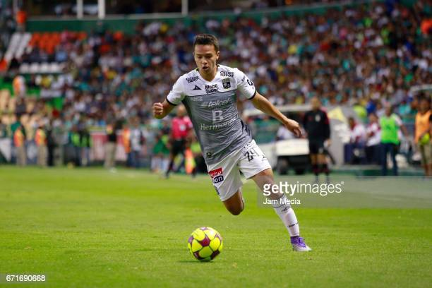 Osvaldo Rodriguez of Leon dirves the ball during the 15th round match between Leon and Puebla as part of the Torneo Clausura 2017 Liga MX at Nou Camp...