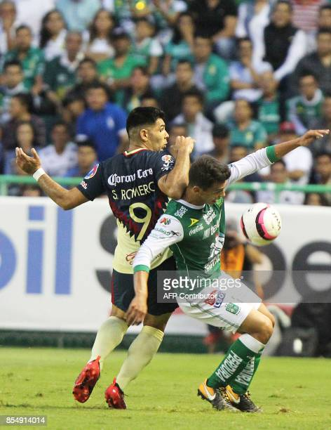 Osvaldo Rodriguez of Leon vies for the ball with Silvio Romero of America during their Mexican Apertura tournament football match at the Nou Camp...