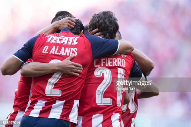 Oswaldo Alanis and Carlos Fierro of Chivas celebrate after a goal scored by their teammate Nestor Calderon during the semi final second leg match...