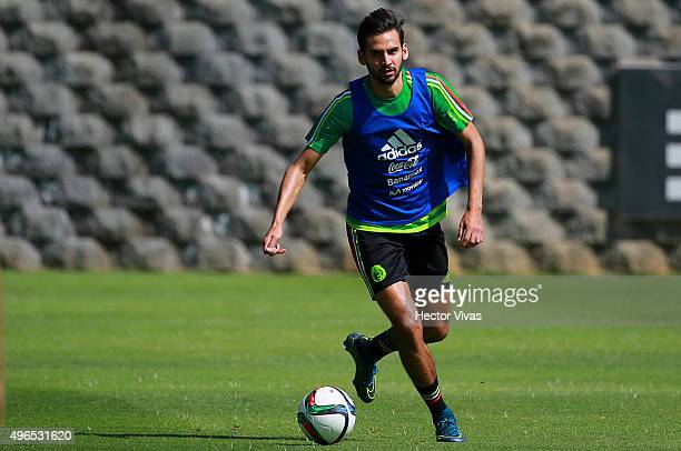 Oswaldo Alanis drives the ball during a training session at Centro de Alto Rendimiento on November 10 2015 in Mexico City Mexico Mexico will face El...
