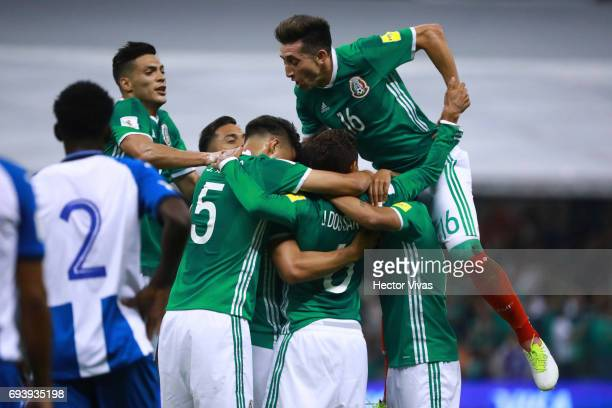 Oswaldo Alanis of Mexico celebrates with teammates after scoring the first goal of his team during the match between Mexico and Honduras as part of...