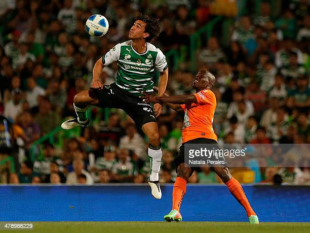 Oswaldo Alanis of Santos and Enner Valencia of Pachuca fight for the ball during a match between Santos Laguna and Pachuca as part of the Round 11th...