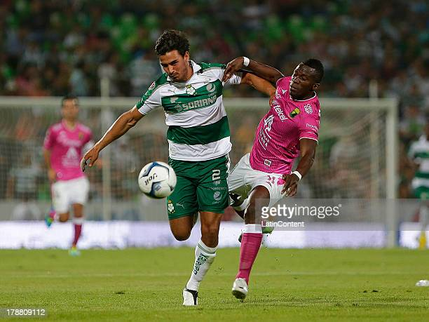 Oswaldo Alanis of Santos drives the ball during a match between Santos and Leon as part of Apertura 2013 Liga Bancomer MX at Modelo Stadium on August...