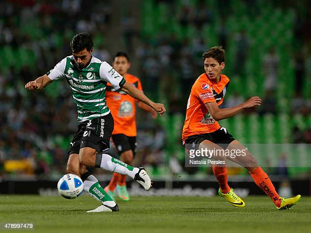 Oswaldo Alanis of Santos drives the ball during a match between Santos Laguna and Pachuca as part of the Round 11th of Clausura 2014 Liga MX at...