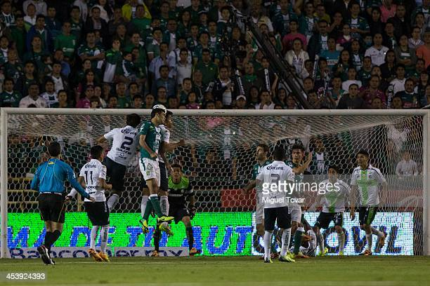 Oswaldo Alanis of Santos fights for the ball with Rafael Marquez of Leon during the leg 1 of a Semifinal match between Leon and Santos Laguna as part...