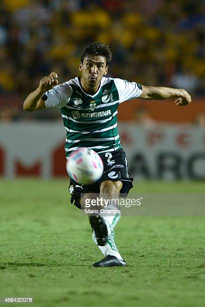 Oswaldo Alanis of Santos kicks the ball during a match between Tigres UANL v Santos Laguna as part of 11th round Apertura 2014 Liga MX at...