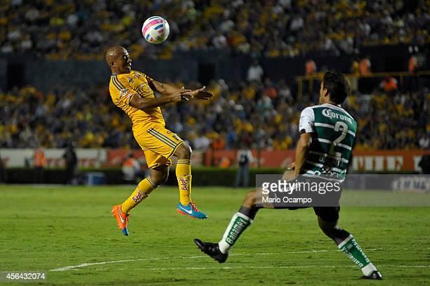 Oswaldo Alanis of Santos observes as Egidio Arevalo of Tigres heads the ball during a match between Tigres UANL v Santos Laguna as part of 11th round...