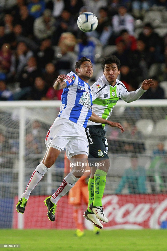 Oswaldo Alanis of Santos struggles for the ball with Daniel Arreola of Pachuca during a match between Pachuca and Santos as part of the Liga MX at Hidalgo stadium on September 21, 2013 in Pachuca, Mexico.