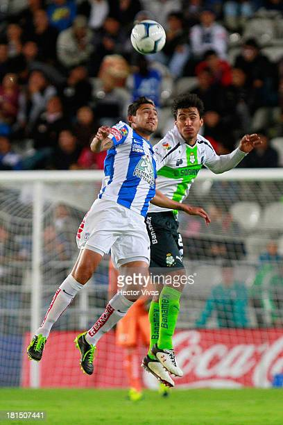 Oswaldo Alanis of Santos struggles for the ball with Daniel Arreola of Pachuca during a match between Pachuca and Santos as part of the Liga MX at...