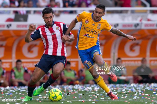 Oswaldo Alanís of Chivas fights for the ball with Victor Sosa of Tigres during the Final second leg match between Chivas and Tigres UANL as part of...