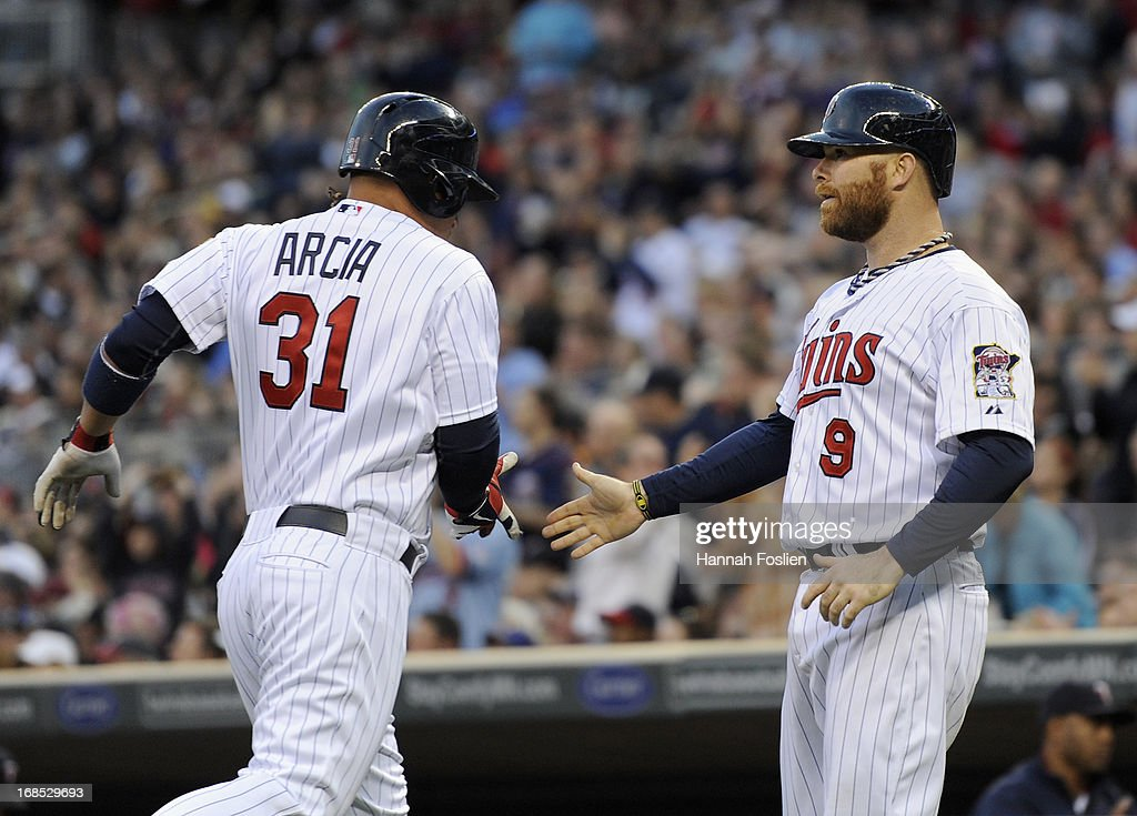 Oswaldo Arcia #31 and Ryan Doumit #9 of the Minnesota Twins celebrate scoring runs against the Baltimore Orioles during the second inning of the game on May 10, 2013 at Target Field in Minneapolis, Minnesota.