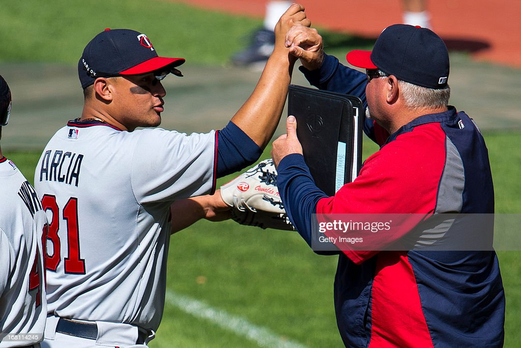 <a gi-track='captionPersonalityLinkClicked' href=/galleries/search?phrase=Oswaldo+Arcia&family=editorial&specificpeople=8948415 ng-click='$event.stopPropagation()'>Oswaldo Arcia</a> #31 celebrates with <a gi-track='captionPersonalityLinkClicked' href=/galleries/search?phrase=Ron+Gardenhire&family=editorial&specificpeople=220870 ng-click='$event.stopPropagation()'>Ron Gardenhire</a> #35 of the Minnesota Twins after the Twins defeated the Cleveland Indians at Progressive Field on May 5, 2013 in Cleveland, Ohio. The Twins defeated the Indians 4-2.