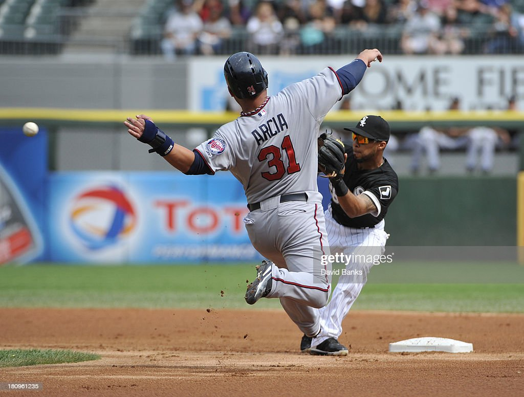<a gi-track='captionPersonalityLinkClicked' href=/galleries/search?phrase=Oswaldo+Arcia&family=editorial&specificpeople=8948415 ng-click='$event.stopPropagation()'>Oswaldo Arcia</a> #31 of the Minnesota Twins attempts to steal second base and is tagged out by Leury Garcia #28 of the Chicago White Sox during the first inning on September 18, 2013 at U.S. Cellular Field in Chicago, Illinois.