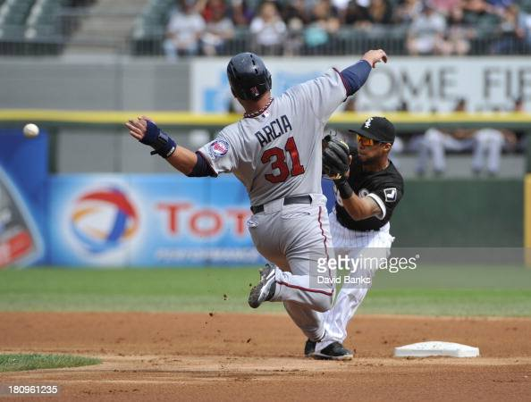 Oswaldo Arcia of the Minnesota Twins attempts to steal second base and is tagged out by Leury Garcia of the Chicago White Sox during the first inning...