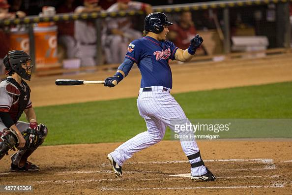 Oswaldo Arcia of the Minnesota Twins bats against the Arizona Diamondbacks on September 23 2014 at Target Field in Minneapolis Minnesota The Twins...