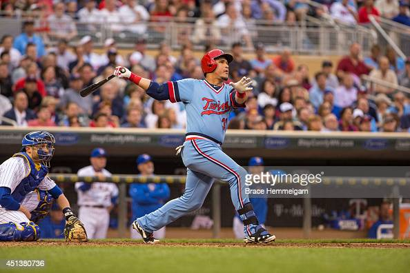 Oswaldo Arcia of the Minnesota Twins bats against the Milwaukee Brewers on June 5 2014 at Target Field in Minneapolis Minnesota The Brewers defeated...