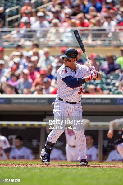 Oswaldo Arcia of the Minnesota Twins bats against the Texas Rangers on May 29 2014 at Target Field in Minneapolis Minnesota The Rangers defeated the...