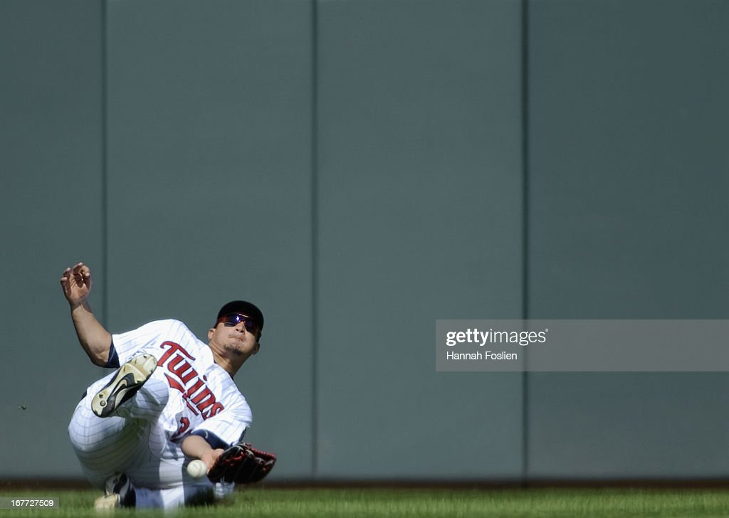 <a gi-track='captionPersonalityLinkClicked' href=/galleries/search?phrase=Oswaldo+Arcia&family=editorial&specificpeople=8948415 ng-click='$event.stopPropagation()'>Oswaldo Arcia</a> #31 of the Minnesota Twins bobbles a catch in left field during the eighth inning of the game against the Texas Rangers on April 28, 2013 at Target Field in Minneapolis, Minnesota. The Twins defeated the Ranger 5-0.