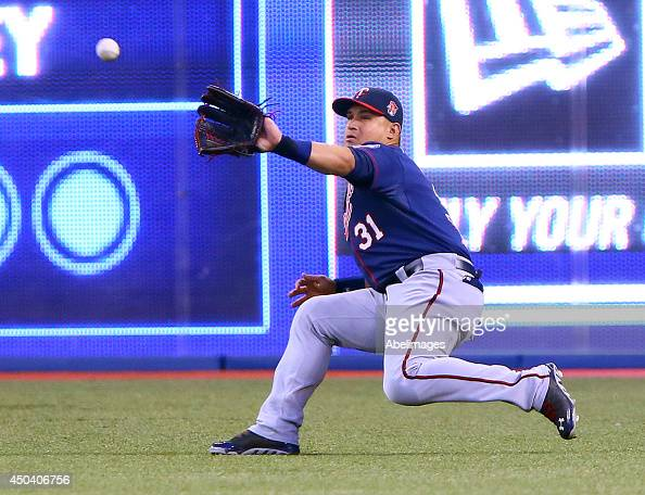 Oswaldo Arcia of the Minnesota Twins catches a Jose Reyes of the Toronto Blue Jays fly ball during MLB action at the Rogers Centre June 10 2014 in...