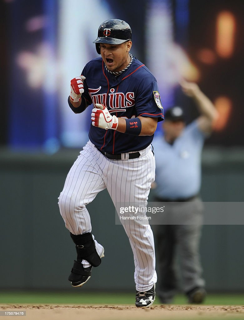 <a gi-track='captionPersonalityLinkClicked' href=/galleries/search?phrase=Oswaldo+Arcia&family=editorial&specificpeople=8948415 ng-click='$event.stopPropagation()'>Oswaldo Arcia</a> #31 of the Minnesota Twins celebrates as he rounds the bases as second base umpire Bob Davidson #61 signals a home run during the seventh inning of the game between the Minnesota Twins and the Houston Astros on August 4, 2013 at Target Field in Minneapolis, Minnesota. The Twins defeated the Astros 3-2.