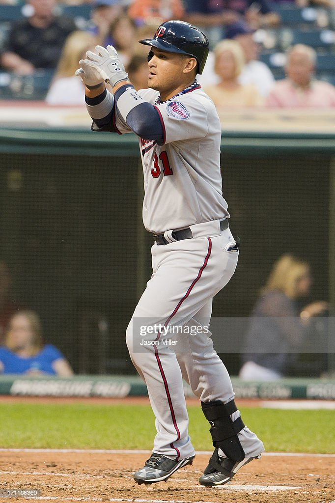 <a gi-track='captionPersonalityLinkClicked' href=/galleries/search?phrase=Oswaldo+Arcia&family=editorial&specificpeople=8948415 ng-click='$event.stopPropagation()'>Oswaldo Arcia</a> #31 of the Minnesota Twins celebrates as he touches home plate after hitting a solo home run during the fourth inning against the Cleveland Indians at Progressive Field on June 22, 2013 in Cleveland, Ohio.