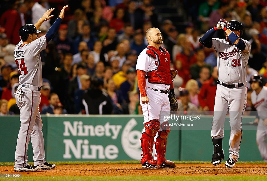 <a gi-track='captionPersonalityLinkClicked' href=/galleries/search?phrase=Oswaldo+Arcia&family=editorial&specificpeople=8948415 ng-click='$event.stopPropagation()'>Oswaldo Arcia</a> #31 of the Minnesota Twins celebrates at home plate with teammate <a gi-track='captionPersonalityLinkClicked' href=/galleries/search?phrase=Trevor+Plouffe&family=editorial&specificpeople=5722348 ng-click='$event.stopPropagation()'>Trevor Plouffe</a> #24 of the Minnesota Twins in front of <a gi-track='captionPersonalityLinkClicked' href=/galleries/search?phrase=David+Ross+-+Baseball+Player&family=editorial&specificpeople=210843 ng-click='$event.stopPropagation()'>David Ross</a> #3 of the Boston Red Sox after hitting a two-run home run in the sixth inning during the game on May 9, 2013 at Fenway Park in Boston, Massachusetts.