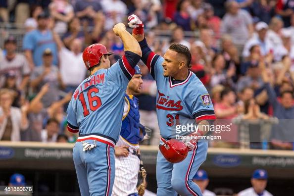 Oswaldo Arcia of the Minnesota Twins celebrates with Josh Willingham against the Milwaukee Brewers on June 5 2014 at Target Field in Minneapolis...