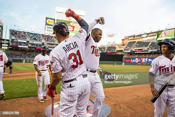Oswaldo Arcia of the Minnesota Twins celebrates with Kennys Vargas against the Chicago White Sox on September 2 2014 at Target Field in Minneapolis...