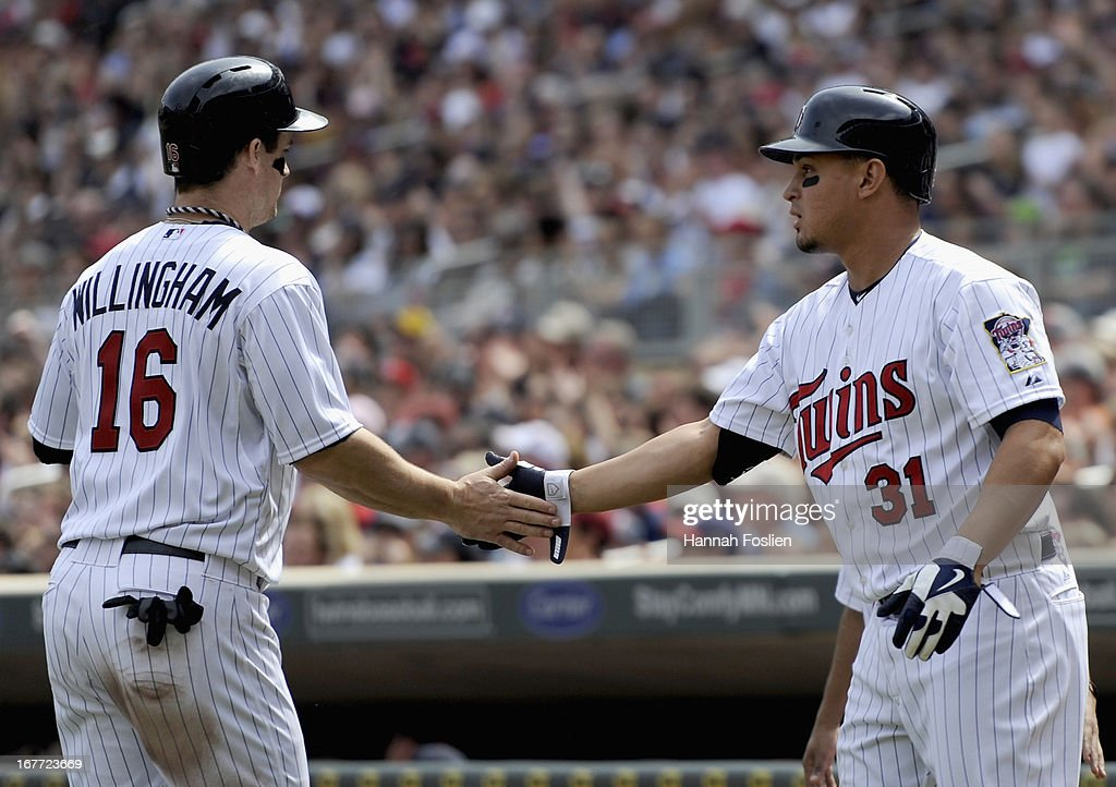 Oswaldo Arcia #31 of the Minnesota Twins congratulates teammate Josh Willingham #16 on a scoring a run against the Texas Rangers during the fourth inning of the game on April 28, 2013 at Target Field in Minneapolis, Minnesota.