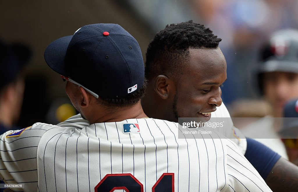 <a gi-track='captionPersonalityLinkClicked' href=/galleries/search?phrase=Oswaldo+Arcia&family=editorial&specificpeople=8948415 ng-click='$event.stopPropagation()'>Oswaldo Arcia</a> #31 of the Minnesota Twins congratulates teammate Miguel Sano #22 on a two-run home run against the Kansas City Royals during the fifth inning of the game on May 25, 2016 at Target Field in Minneapolis, Minnesota. The Twins defeated the Royals 7-5.