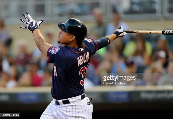 Oswaldo Arcia of the Minnesota Twins hits a threerun home run against the Cleveland Indians during the first inning of the game on August 19 2014 at...