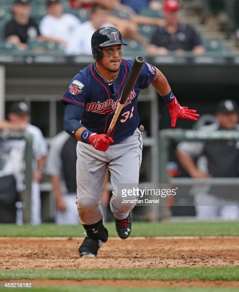 Oswaldo Arcia of the Minnesota Twins hits a tworun single in the 8th inning against the Chicago White Sox at US Cellular Field on August 3 2014 in...