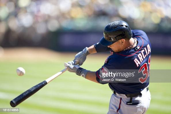 Oswaldo Arcia of the Minnesota Twins hits an RBI single against the Oakland Athletics during the first inning at Oco Coliseum on September 22 2013 in...