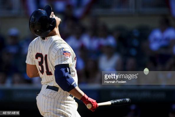 Oswaldo Arcia of the Minnesota Twins is hit by a pitch during the game against the New York Yankees on July 5 2014 at Target Field in Minneapolis...