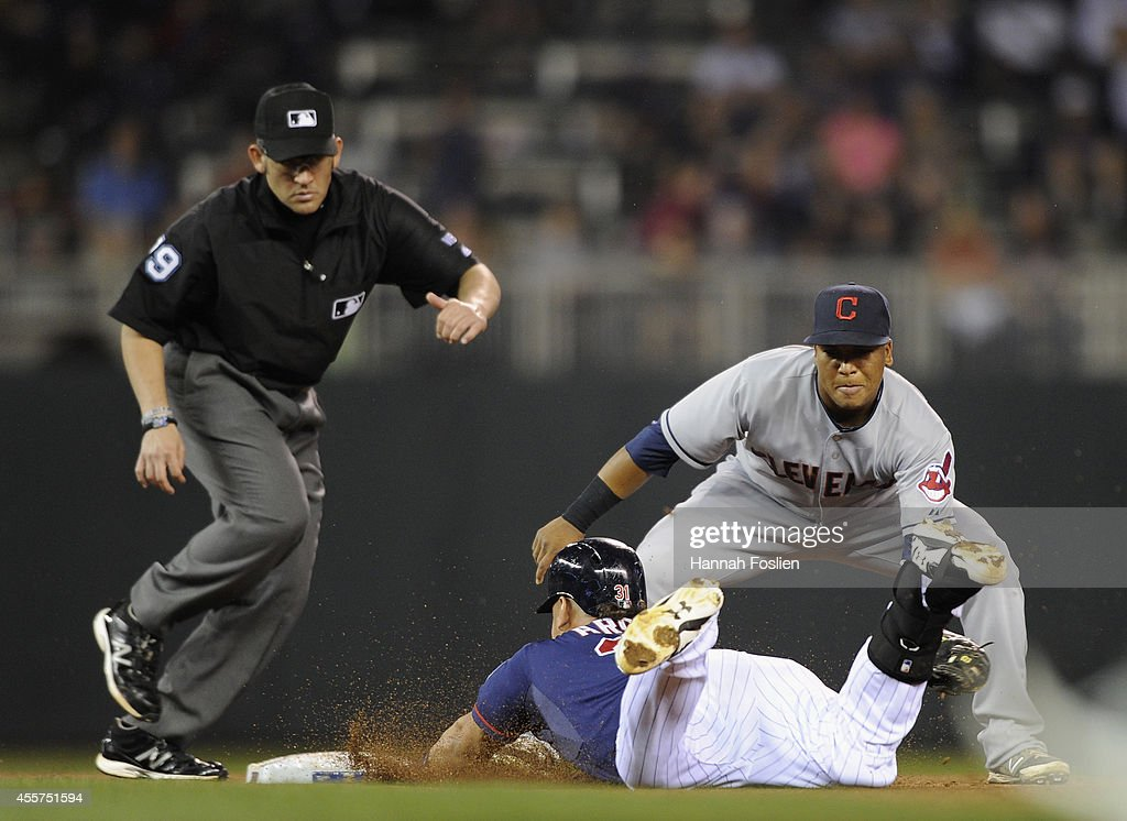 <a gi-track='captionPersonalityLinkClicked' href=/galleries/search?phrase=Oswaldo+Arcia&family=editorial&specificpeople=8948415 ng-click='$event.stopPropagation()'>Oswaldo Arcia</a> #31 of the Minnesota Twins is out at second base as Jose Ramirez #11 of the Cleveland Indians fields the ball during the fifth inning of the game on September 19, 2014 at Target Field in Minneapolis, Minnesota. The Twins defeated the Indians 5-4 in ten innings.